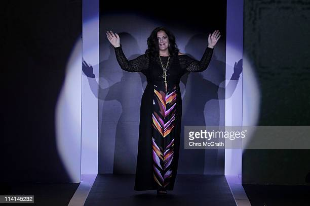 Designer Angela Missoni waves to the crowd after her show during Audi Fashion Festival Singapore 2011 at Tent@Orchard on May 13, 2011 in Singapore.