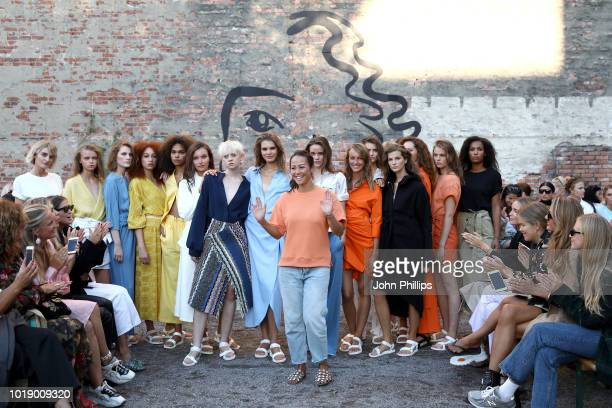 Designer AnhMarthe Storheil and models acknowledge the applause of the audience after the Iben show during Oslo Runway SS19 at Prindsen Hage on...