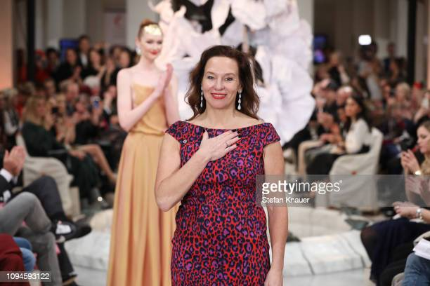 Designer Anja Gockel acknowledges the applause of the audience after her show during the Berlin Fashion Week Autumn/Winter 2019 at Hotel Adlon on...