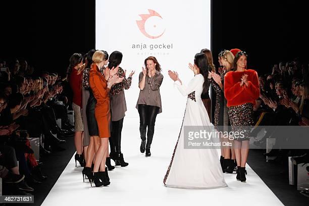 Designer Anja Gockel acknowledges the audience at the Anja Gockel show during MercedesBenz Fashion Week Autumn/Winter 2014/15 at Brandenburg Gate on...
