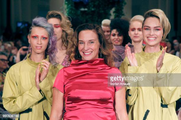 Designer Anja Gockel ackowledges the applause of the audience during her show during the Berlin Fashion Week Spring/Summer 2019 at Hotel Adlon on...