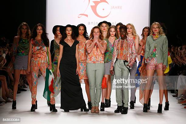 Designer Anja Gockel and a group of models acknowledge the applause of the audience at the runway after her show during the MercedesBenz Fashion Week...