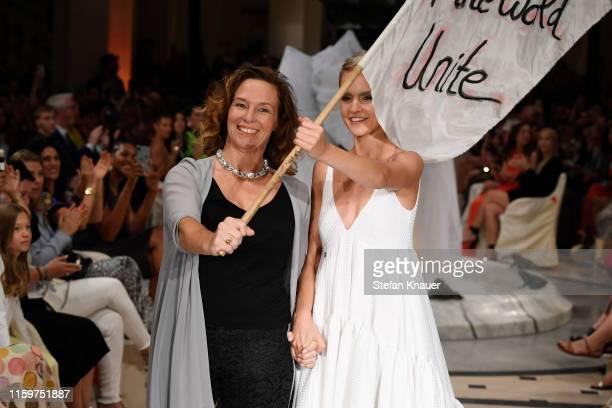 Designer Anja Gockel and a model at the Anja Gockel show during the Berlin Fashion Week Spring/Summer 2020 at Hotel Adlon on July 02 2019 in Berlin...