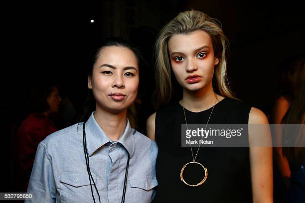 Designer Anna Hoang poses with a model backstage ahead of the St.George Project NextGen show at Mercedes-Benz Fashion Week Resort 17 Collections at...