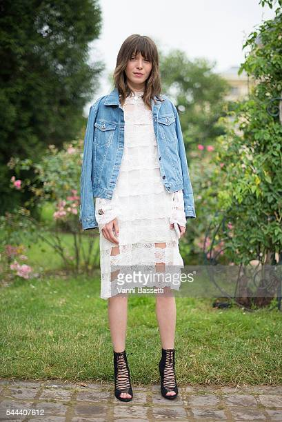 Designer Anna K poses wearing an Anna K dress before the Ulyana Sergeenko show at Galerie de la Mineralogie during Paris Fashion Week Haute Couture...