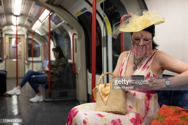 Designer Anna Kompaniets wears a self made face mask as she rides the underground to work in central London on June 01 2020 in London England The...