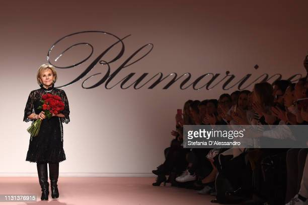 Designer Anna Molinari acknowledges the applause of the public after the Blumarine show at Milan Fashion Week Autumn/Winter 2019/20 on February 22...