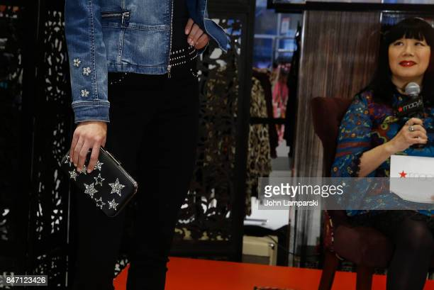 Designer Anna Sui and a model displaying fashion attend Macy's celebration of the launch of Anna Sui x INC at Macy's Herald Square on September 14...