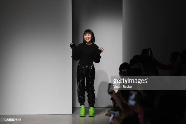 Designer Anna Yang acknowledges the applause of the audience after the Annakiki show during Milan Fashion Week Spring/Summer 2019 on September 19...