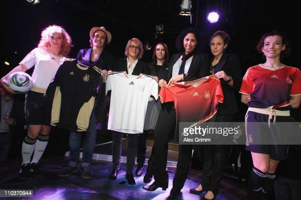 Designer Annette Kres poses with Steffi Jones head of the organization committee Nadine Angerer Kim Kulig and Saskia Bartusiak of the German national...