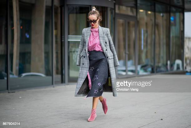 Designer Anouki Areshidze wearing her own designed denim skirt with star print and red white checked top Balenciaga checked coat velvet ankle boots...