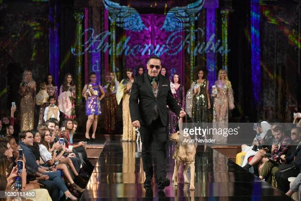 Designer Anthony Rubio and dog walks the runway during the ANTHONY RUBIO show at New York Fashion Week Powered By Art Hearts Fashion at The Angel...