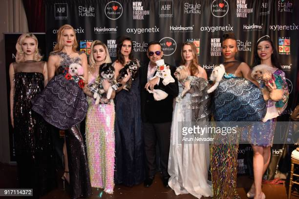 Designer Anthony Rubio poses with models backstage during New York Fashion Week Powered by Art Hearts Fashion NYFW at The Angel Orensanz Foundation...