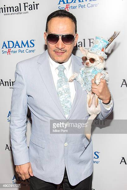 Designer Anthony Rubio with dog Kimba attend the 12th Annual Animalfaircom Paws For Style Fashion Show at Pacha on May 13 2014 in New York City