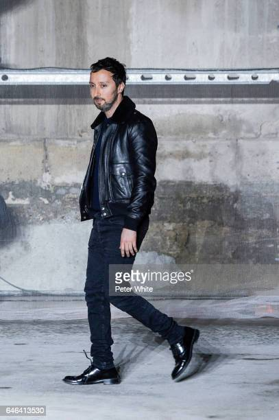 Designer Anthony Vaccarello walks the runway after the Saint Laurent show as part of the Paris Fashion Week Womenswear Fall/Winter 2017/2018 >> on...