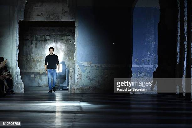 Designer Anthony Vaccarello walks the runway during the Saint Laurent show as part of the Paris Fashion Week Womenswear Spring/Summer 2017 on...