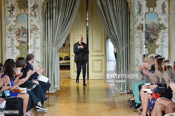 Designer Antonio Grimaldi acknowledges the audience during the Antonio Grimaldi show as part of Paris Fashion Week Womenswear Spring/Summer 2015 on...
