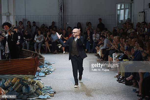 Designer Antonio Marras acknowledges the applause of the public after the Antonio Marras show as part of Milan Men's Fashion Week Spring/Summer 2016...
