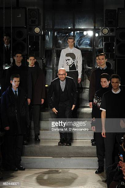 Designer Antonio Marras acknowledges the audience at the end of the Marras show as a part of Milan Fashion Week Menswear Autumn/Winter 2014 on...