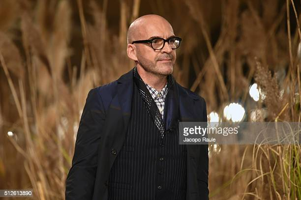 Designer Antonio Marras aknowledge the applause of the public after the Antonio Marras show during Milan Fashion Week Fall/Winter 2016/17 on February...