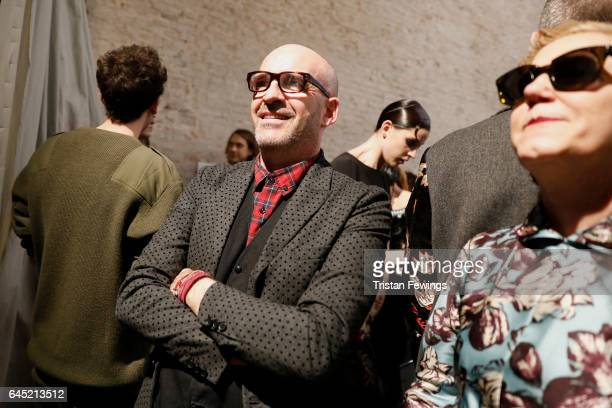 Designer Antonio Marras poses with models backstage ahead of the Antonio Marras show during Milan Fashion Week Fall/Winter 2017/18 on February 25...