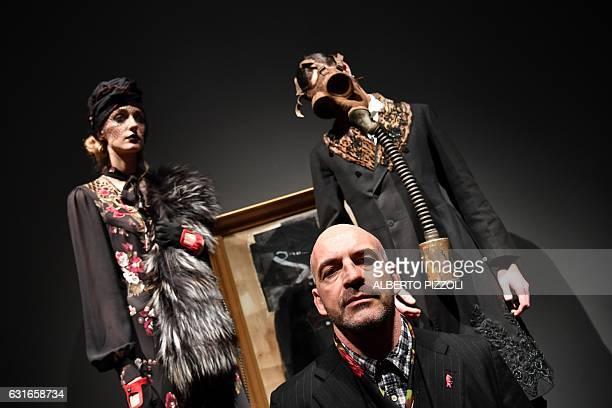 Designer Antonio Marras poses with models during the Men's FallWinter 20172018 fashion week on January 14 2017 in Milan / AFP / Alberto PIZZOLI