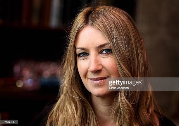 Designer Anya Hindmarch poses for a portrait inside the specially designed 'Bag and Bottle' pub in Knightsbridge on March 23 2010 in London England...