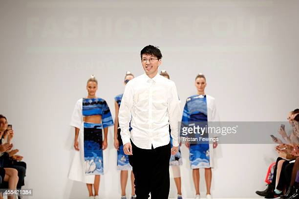 Designer Apu Jan appears on the runway after the Apu Jan show during London Fashion Week Spring Summer 2015 at Fashion Scout Venue on September 14...