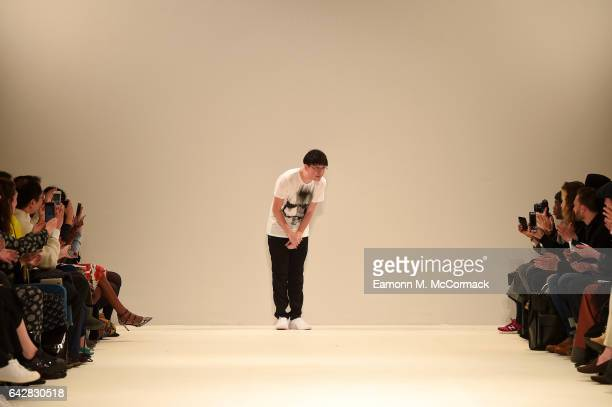 Designer Apu Jan salutes the crowd following the Apu Jan show during the London Fashion Week February 2017 collections on February 19 2017 in London...