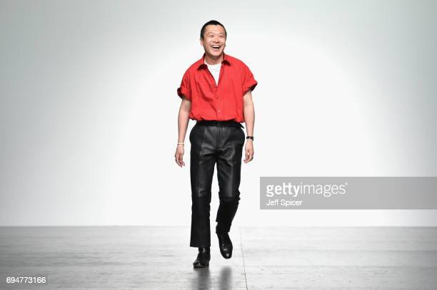 Designer Arashi Yanagawa appears on the runway following the runway at the John Lawrence Sullivan show during the London Fashion Week Men's June 2017...