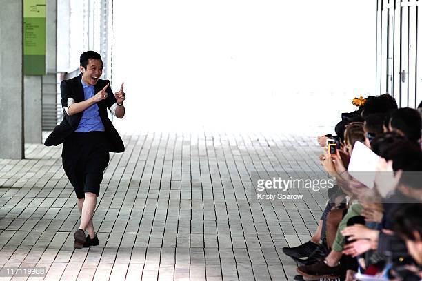 Designer Arashi Yanagawa walks the runway during the John Lawrence Sullivan Menswear Spring/Summer 2012 show as part of Paris Fashion Week at Docks...