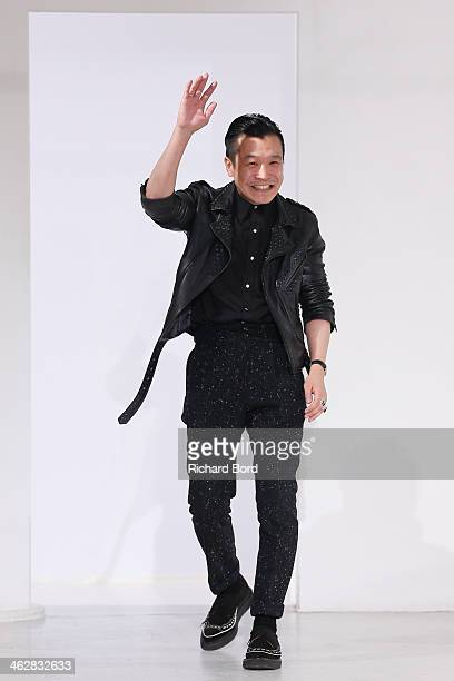 Designer Arashi Yanagawa walks the runway during the John Lawrence Sullivan Menswear Fall/Winter 20142015 show as part of Paris Fashion Week on...