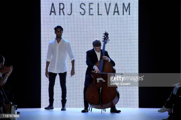 Designer Arj Selvam walks the catwalk after his show during the New Generation 1 catwalk during Rosemount Australian Fashion Week Spring/Summer...