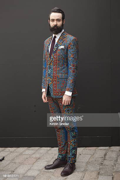 Designer Art Director wearing Dent De Man suit American Apparel tie Brooks Brothers shirt Paul Smith shoes on day 2 of London Womens Fashion Week...