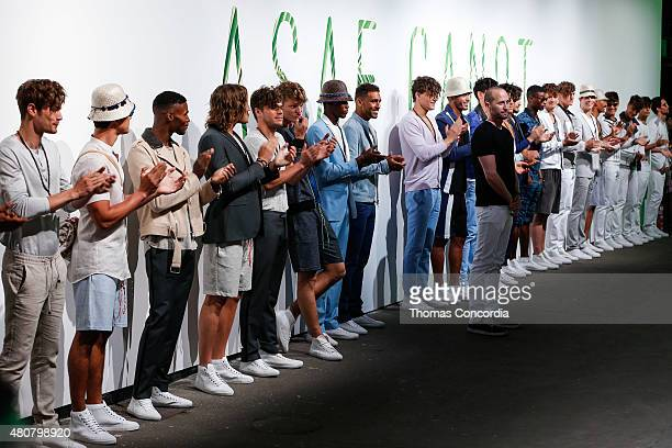 Designer Asaf Ganot poses with the models at ASAF Ganot during New York Fashion Week: Men's S/S 2016 at Art Beam on July 15, 2015 in New York City.