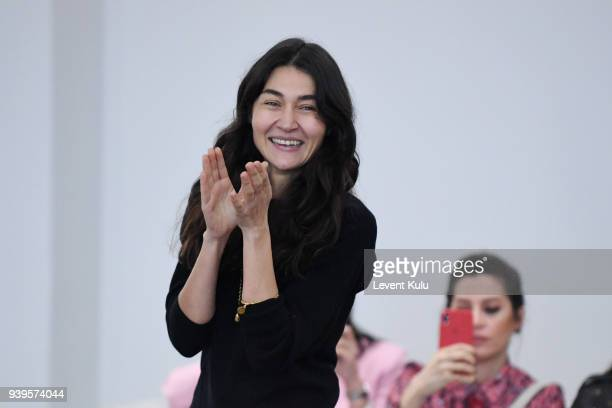 Designer Asli Filinta acknowledges the applause of the audience after her show during Mercedes Benz Fashion Week Istanbul at on March 29 2018 in...