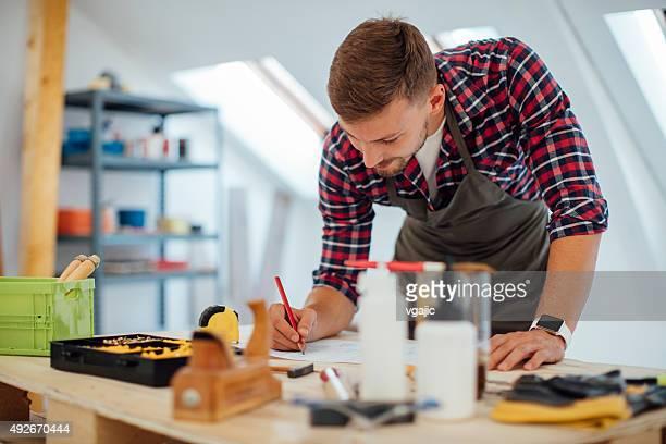 Designer At Work In His Furniture Workshop.