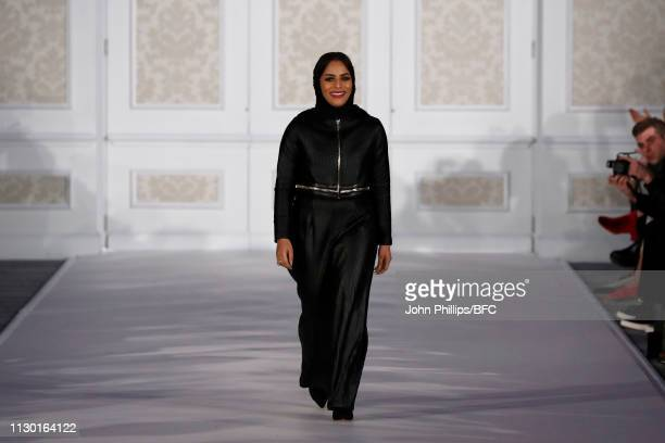 Designer Atelier Zuhra walks the runway during the final Atelier Zuhra show mansion soirèe event during London Fashion Week February 2019 at the on...