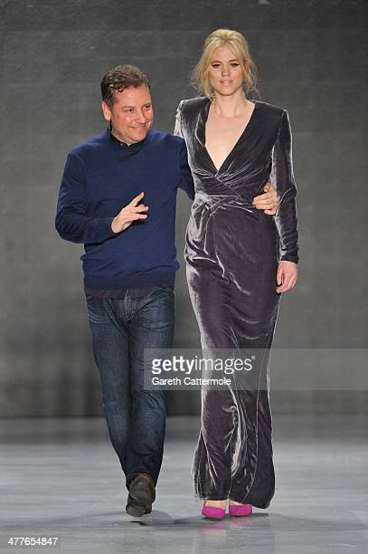 Designer Atil Kutoglu and model Larissa Marolt appear at the end of the runway after the Atil Kutoglu show during MBFWI presented by American Express...