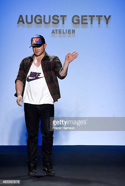Designer August Getty poses on the runway at the August Getty fashion show during MercedesBenz Fashion Week Fall 2015 at The Salon at Lincoln Center...