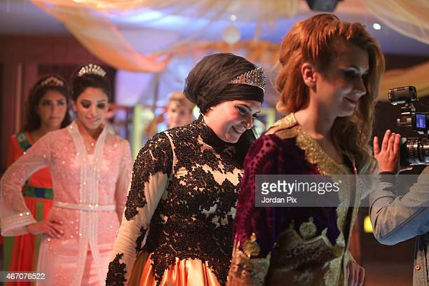 Designer Ayat Al Zoubi walks with models in her annual Abaya fashion show March 20 2015 in Amman Jordan