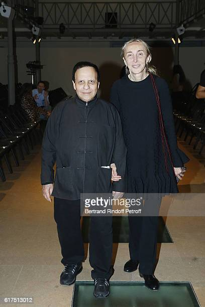 Designer Azzedine Alaia and Carla Sozzani attend the Azzedine Alaia Fashion Show at Azzedine Alaia Gallery on October 23 2016 in Paris France