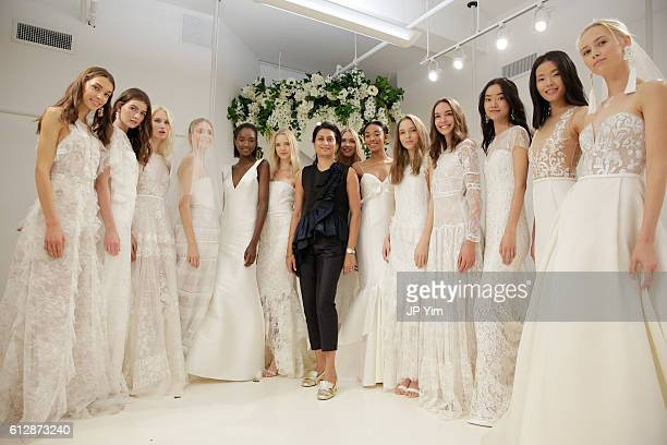 Designer Babi Ahluwalia poses with models at Sachin Babi Fall/Winter 2017 Bridal Collection during New York Bridal Week on October 5 2016 in New York...