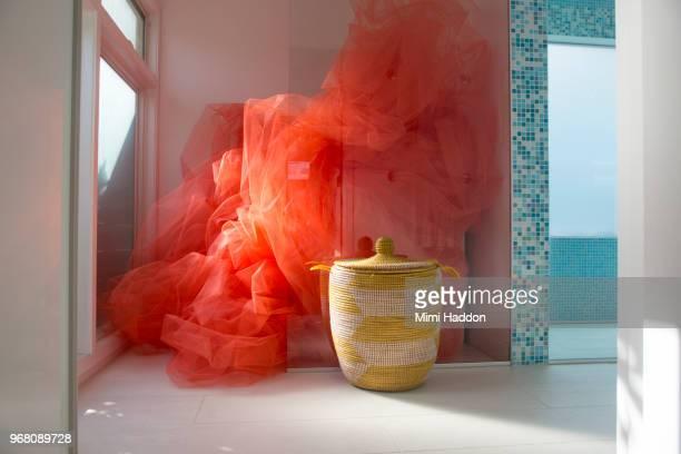 Designer Bathroom Filled with Bright Orange Fabric
