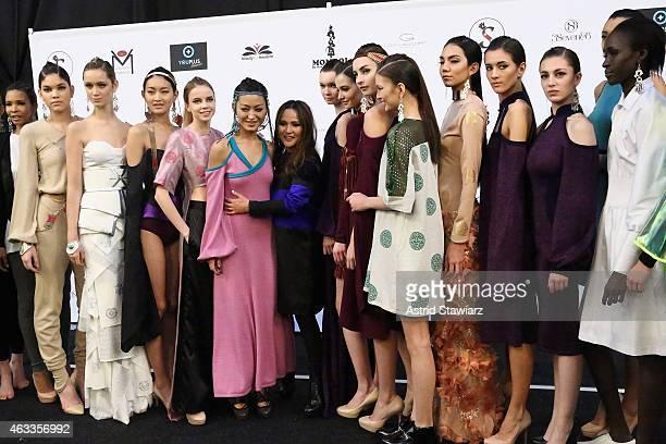 Designer Bayarmaa Bayarkhuu poses backstage with models at the Mongol fashion show during Mercedes-Benz Fashion Week Fall 2015 at The Theatre at...