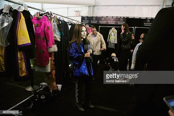 Designer Bayarmaa Bayarkhuu prepares backstage at the Mongol fashion show during Mercedes-Benz Fashion Week Fall 2015 at The Theatre at Lincoln...