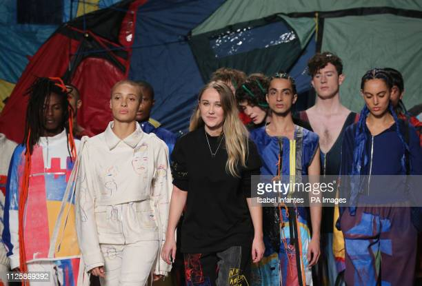 Designer Bethany Williams acknowledges the audience following her Autumn/Winter 2019 London Fashion Week show at the BFC Show Space London