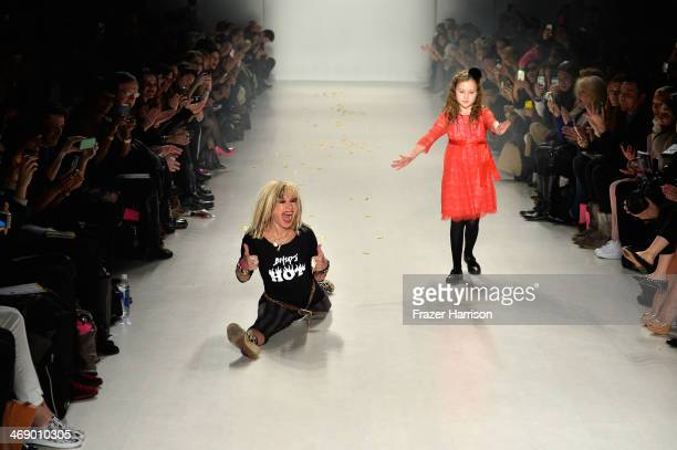 Designer Betsey Johnson and her granddaughter walk the runway at the Betsey Johnson fashion show during MercedesBenz Fashion Week Fall 2014 at The...
