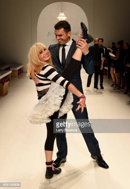 Designer Betsey Johnson and Tony Dovolani dance on the runway at the Betsey Johnson fashion show during MercedesBenz Fashion Week Spring 2015 at The...
