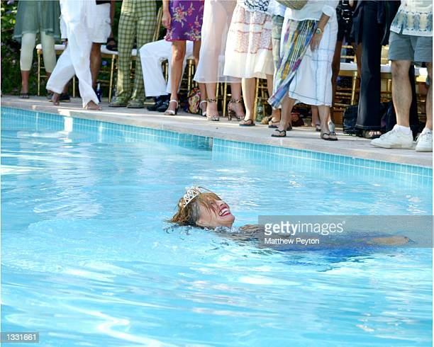 Designer Betsey Johnson swims in her pool to conclude her 60th birthday party and spring/summer 2003 fashion show at her East Hampton home August 10...